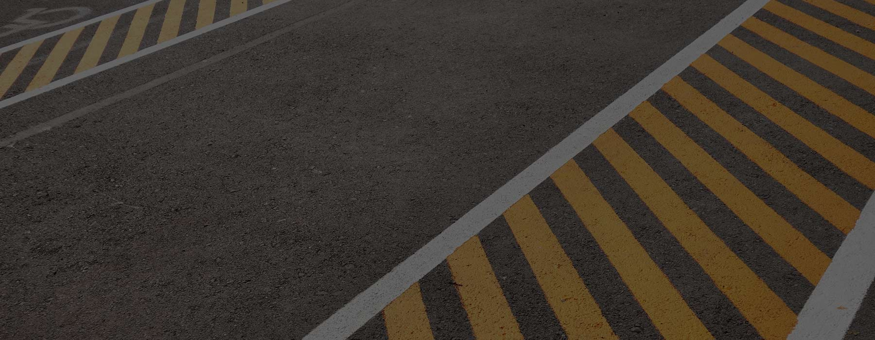 White and yellow striping on asphalt pavement - Southern Striping, LLC